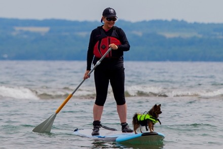Paddleboarder with dog